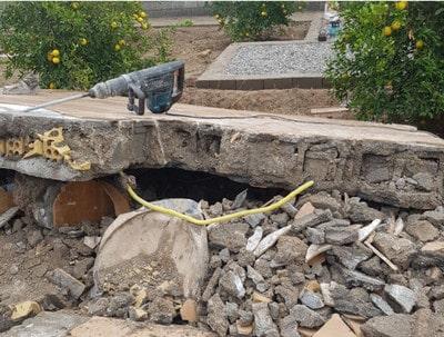 تخریب دیوار سیمانی